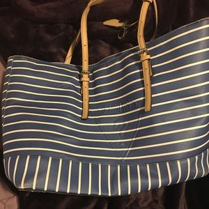 Blue and white striped guess purse with tan straps
